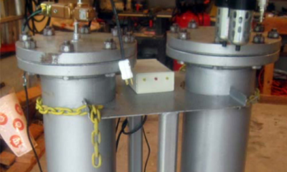 Two cylinders that are paired to make the oxygen concentrator.