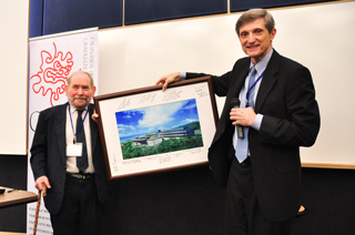 Dr. Baughman presents Dr. Brenner with OIST photo signed by BOG members