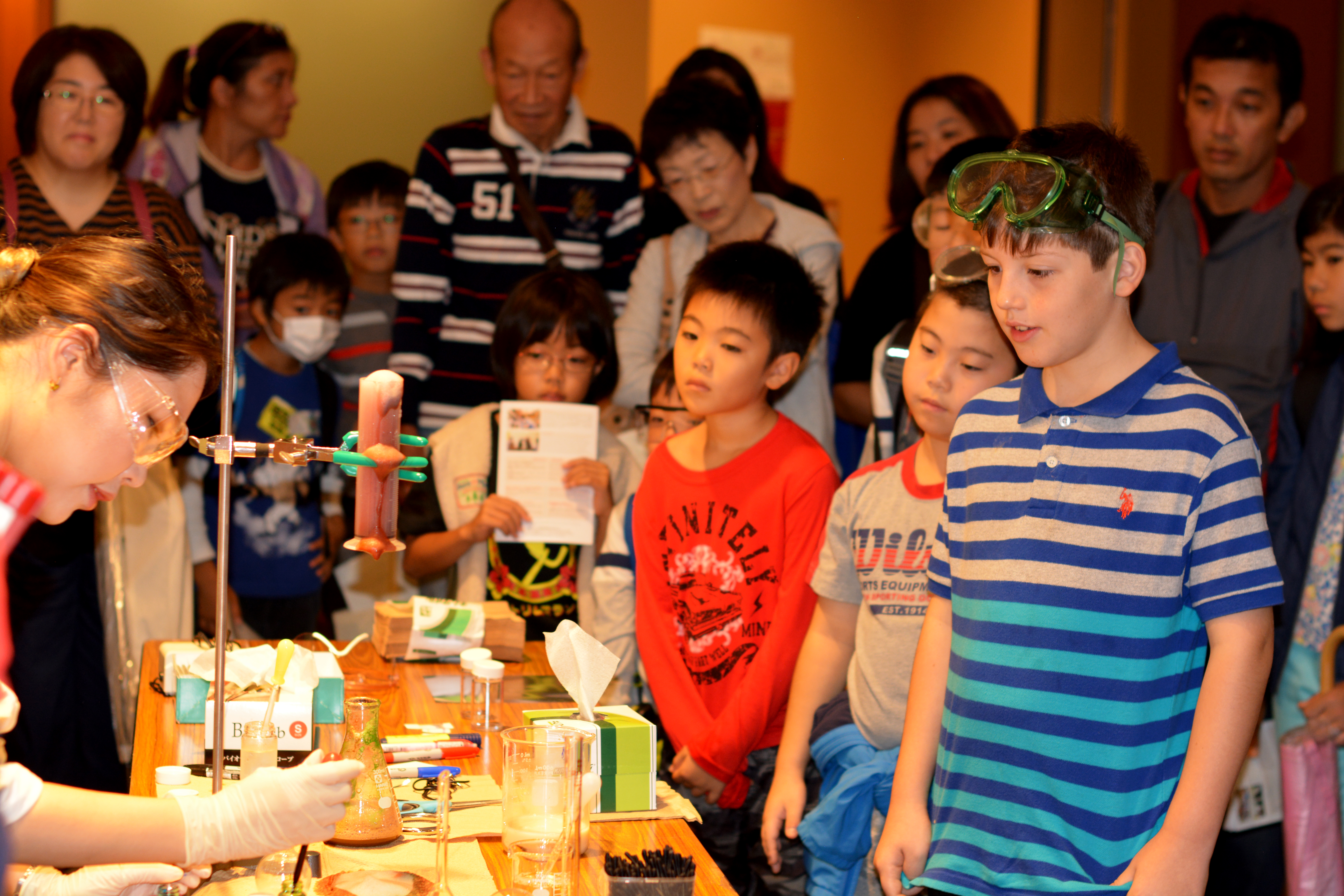 """The """"Chemical Demonstrations"""" booth appeared to be very popular, entrancing both adults and children alike."""