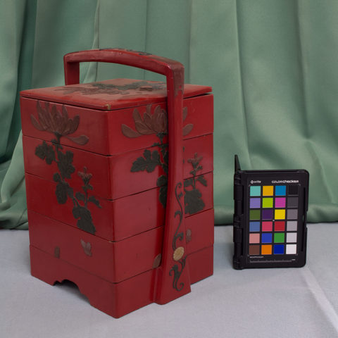 A red bento box belonging to the Yomitan Museum