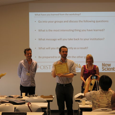 A participant receives his certificate at the ISCW Summer School 2015