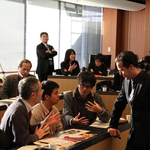 Participants engaging in an English discussion