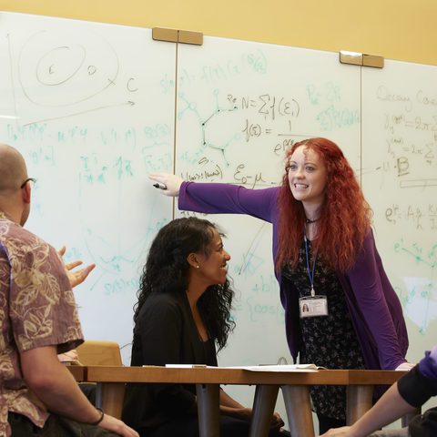 Young OIST researchers in scientific discussion (Photo 1)