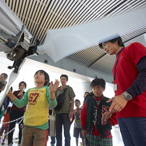Children playing with a prototype propeller of the OIST Sea Project