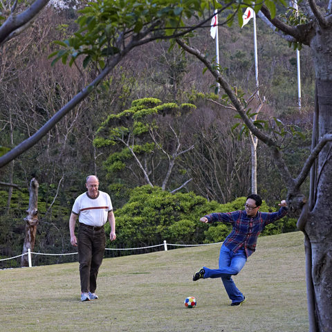 OIST researchers playing soccer after work