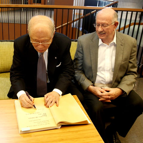 Ryōji Noyori, Nobel Laureate and President of RIKEN, signs the Golden Book